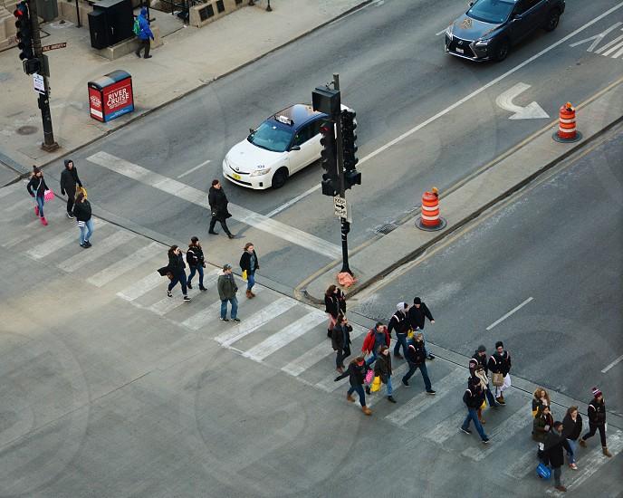 Cross walk people street crossing outside car stoplight cars city citylife photo