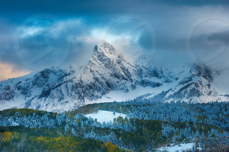 Breaking clouds from early autumn storm over Mt. Sneffels near Ridgway Colorado photo