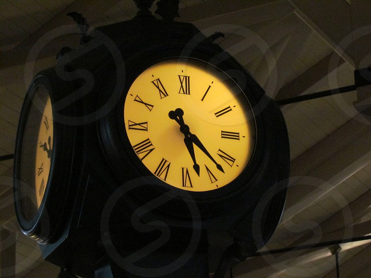 Clock with Roman numerals numbers. Time photo