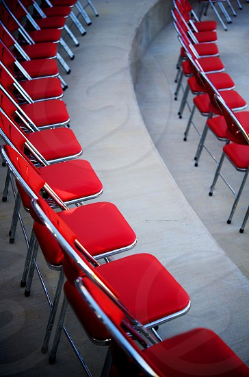 Rows of red chairs photo