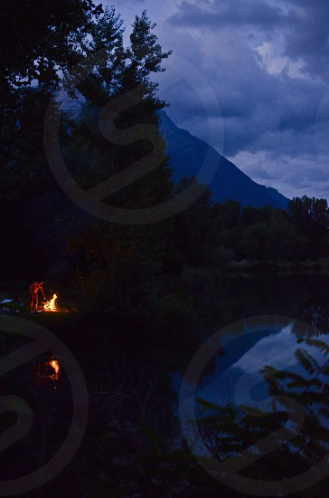 Making dinner at a campfire in the shore of a lake in Haute-Savoie  Auvergne-Rhône-Alpes region France photo