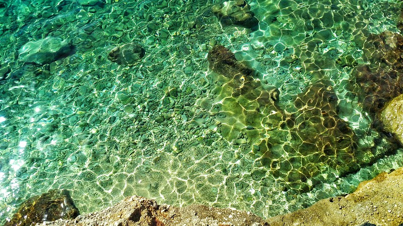 green  all variants of it. amazing reflections in the water of sea at the cost of Croatia. forms  atones  brilliance  rock photo
