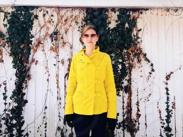 women's yellow coat photo