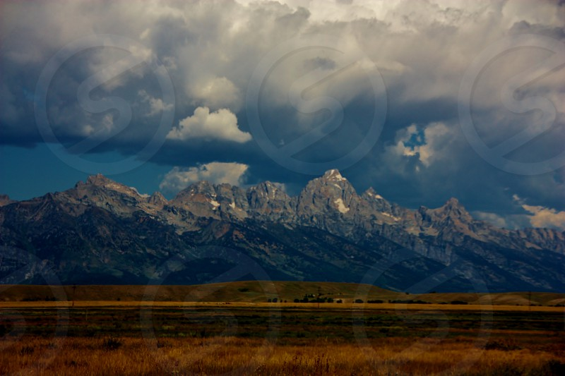 Grand Tetons Wyoming clouds field photo