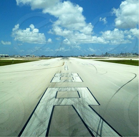 view of airplane runway and blue sky photo