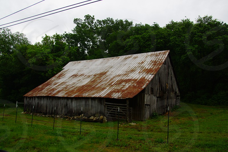 grey roofed brown wooden storage room photo