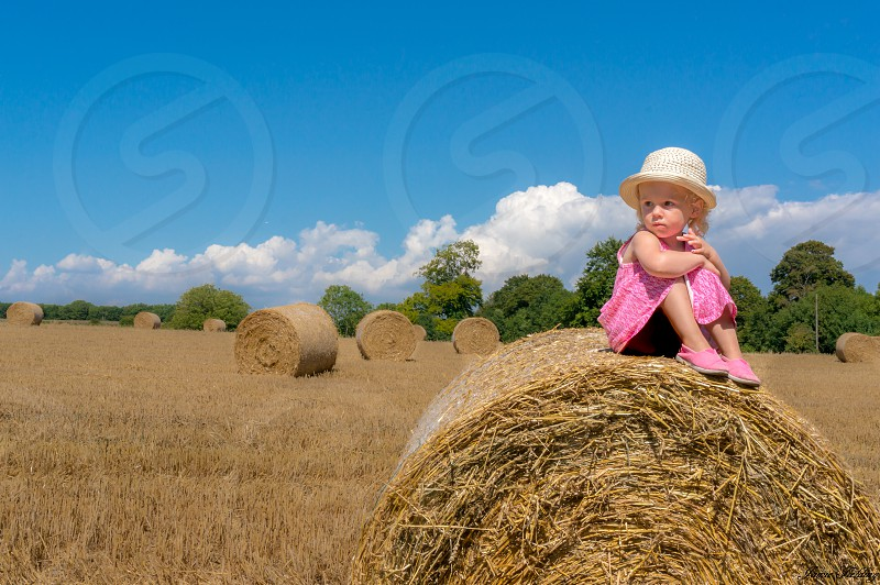 Girl hat field summer haybale pink daughter toddler Skyclouds photo