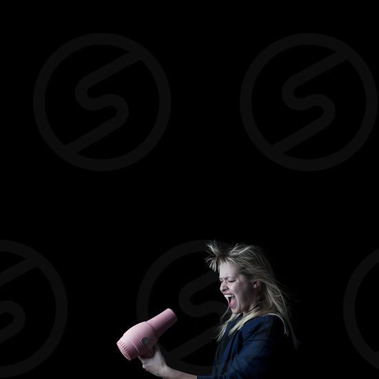 woman screaming at hair dryer photo