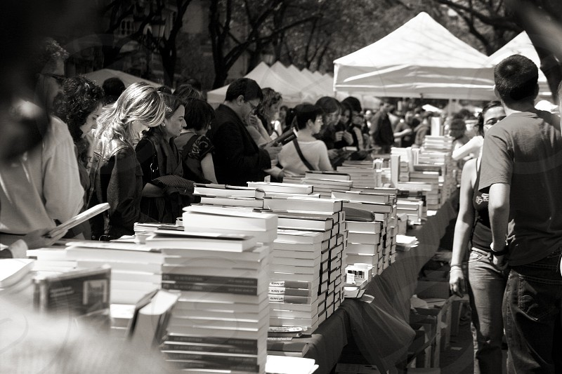 Tables with books on the streets of Barcelona Spain on St. Geordi's Day. Love Valentine's tradition market public literature. photo