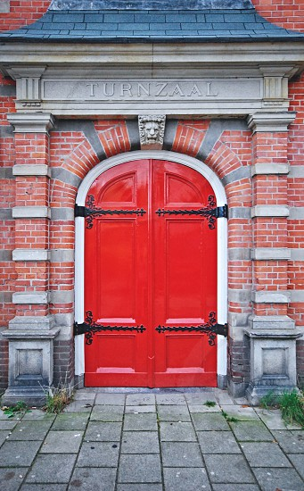 A Red door of an old turnzaal (gymnasium) in Amsterdam Netherlands photo