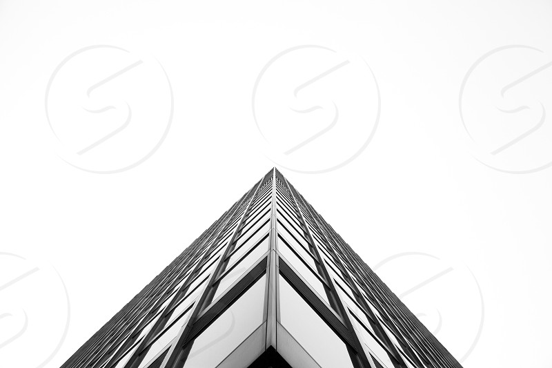 symmetry building architecture corner look up white sky metalic monochrome photo