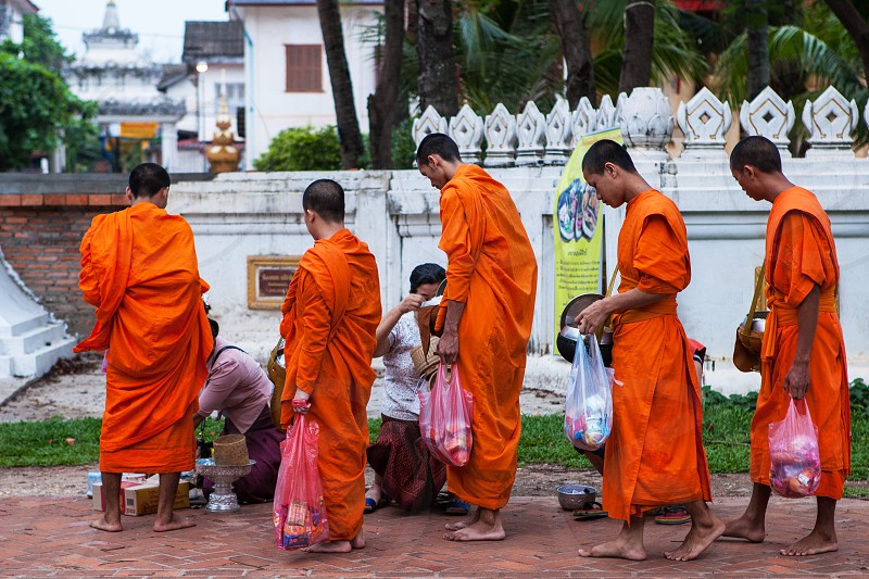 Thai Monks on their Daily Alms Round.  photo