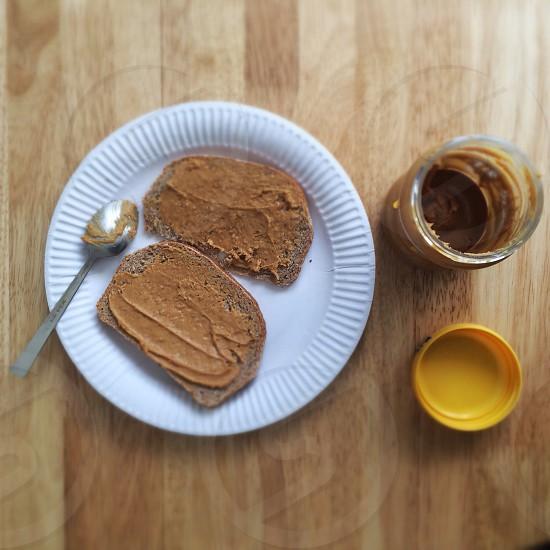 brown peanut bread on white ceramic plate photo
