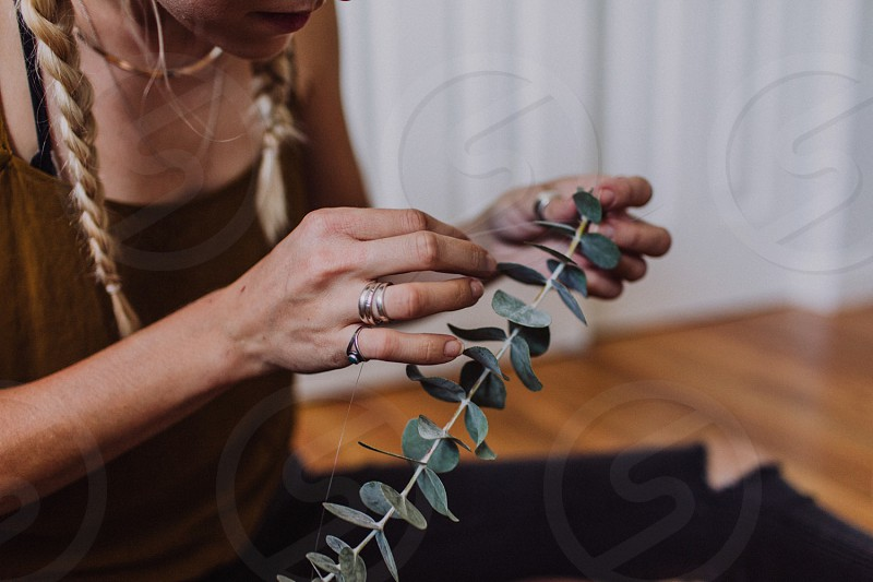 woman making a art using a green leaf plant photo