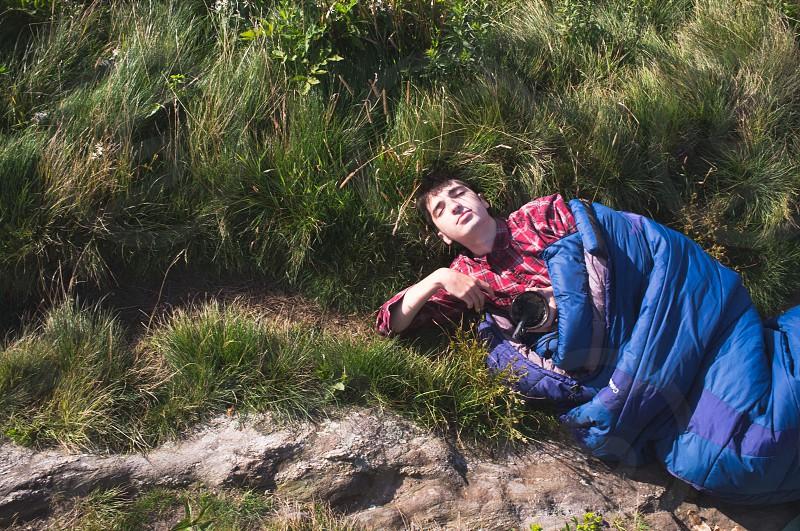man lying on grass photo