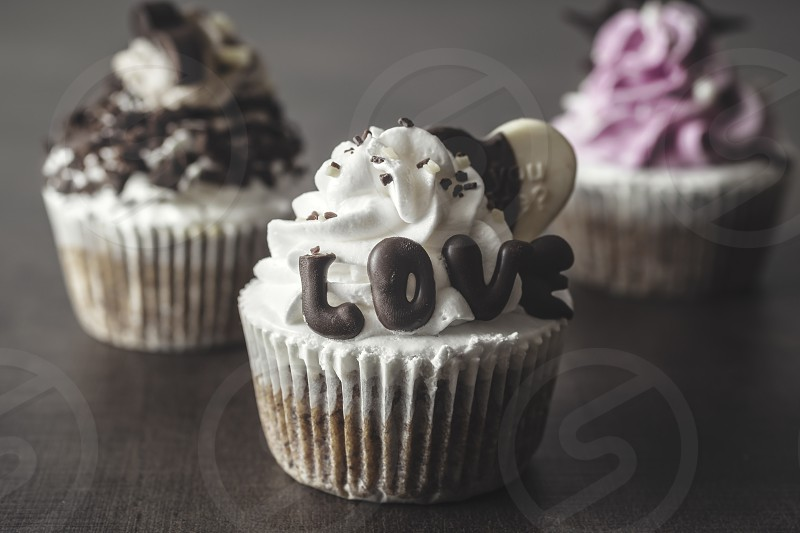 Sweet cupcakes in close up photo