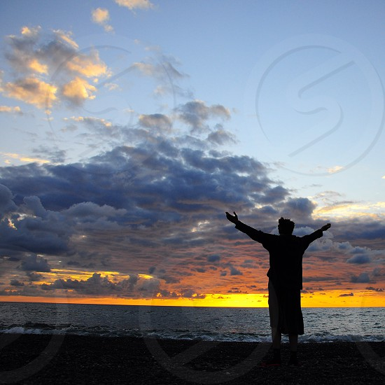 man standing by the sea photo