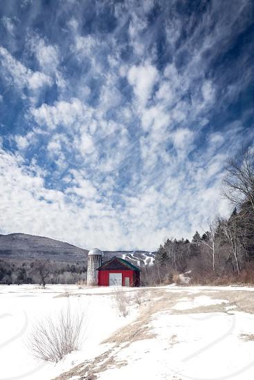 Red barn in winter landscape  photo