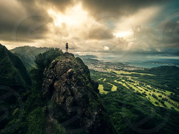 Women cliff mountain top outdoor climbing island Hawaii hike adventure outstanding exploring photo