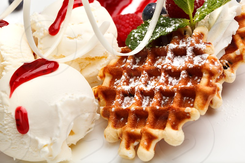Close-up shot of classic restaurant dessert with ice-cream waffles and fresh berries photo