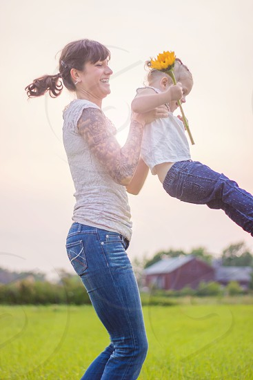 Momma and daughter playing  photo