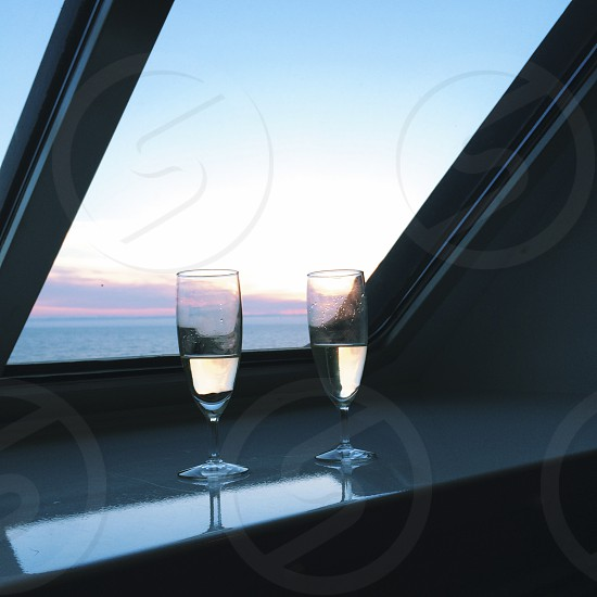 champagne two glasses flutes ship sunset window romance romantic love valentines day photo