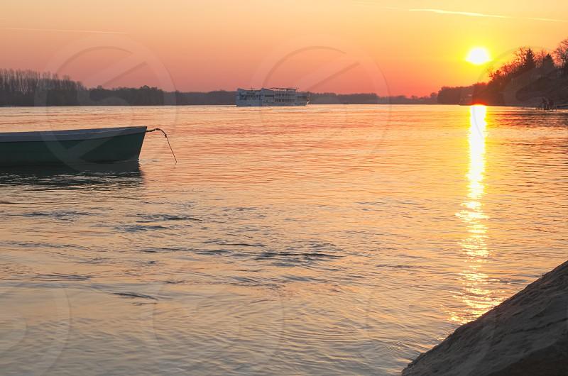 Empty Boat on the Calm Danube River Sunrise photo