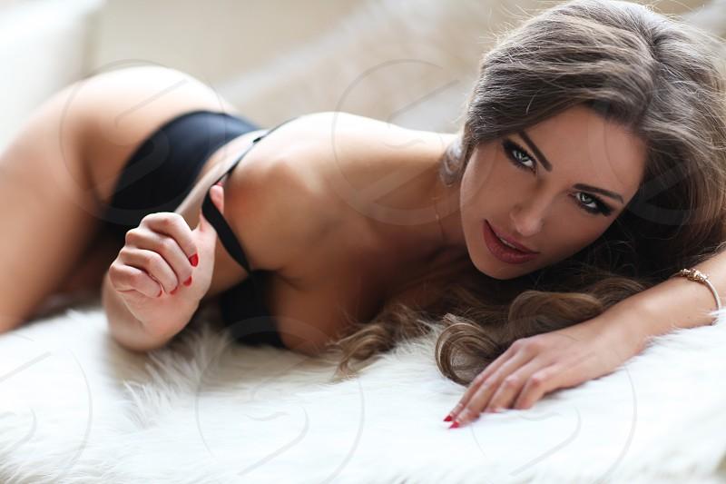 Sexy brunette in black lingerie. photo