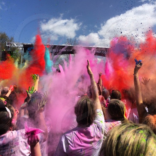 People throwing colored powder at Color Me Rad race in Birmingham AL. photo