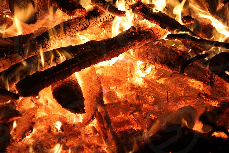 Burning fire wood embers hot photo