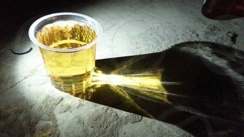 LIGHT PASSING THROUGH WHISKY GLASS  photo