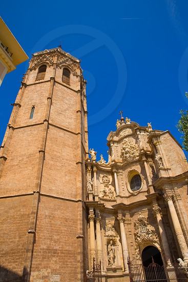 Valencia Cathedral facade and Miguelete Micalet in Plaza de la Reina at Spain photo
