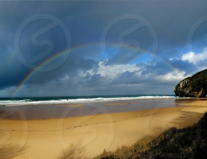laredo spain beach double rainbow photo