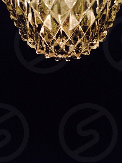 a crystal on a black surface photo