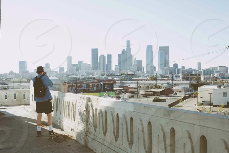man taking photo of cityscape photo