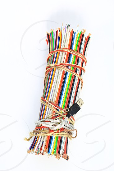 """Topic:""""Bundle of Wires"""" 17  This is an image of a bundle of electronic wires in multiple colors tied up with string with copy space and a clean white background. photo"""