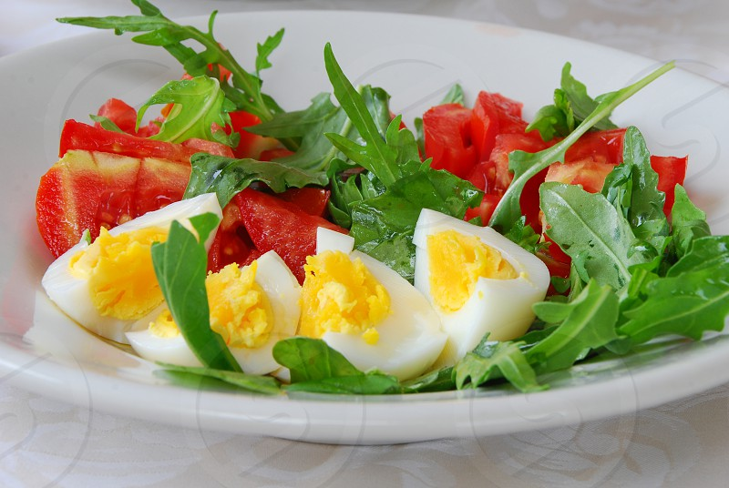 Summer salad with eggs from local farm and tomatoes from our garden photo