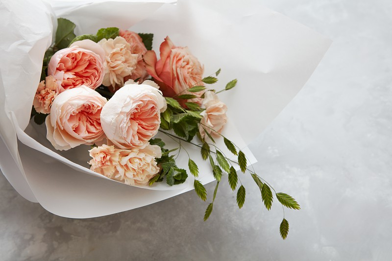 Woman's Day concept. Bouquet of roses for giving as gift or present. Bouquet of roses represented over white background. photo