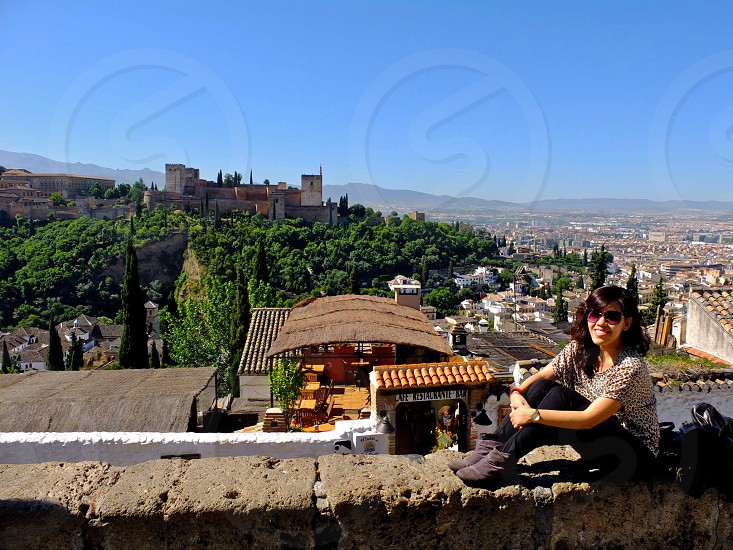 asian girl traveling europe solo trip backpacker travel wander spain granada overlooking photo