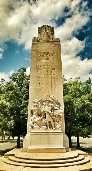 monument sculpture sky blue clouds photo