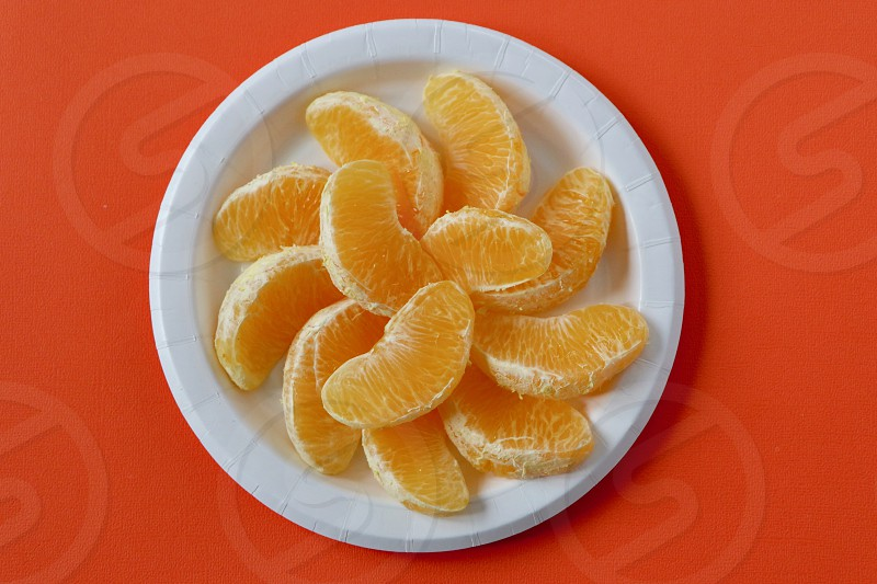 A plate of peeled orange slices ready for breakfast. photo