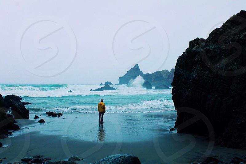male near ocean photo