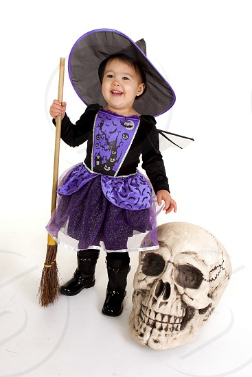 baby in purple and black witch costume photo