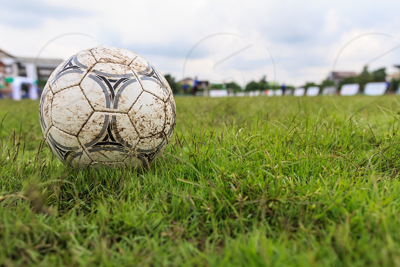Nakhon Ratchasima Thailand - October 1 : Muddy soccer ball on a football field in Municipal Stadium Nakhon Ratchasima on October 1 2016 in Thailand. photo