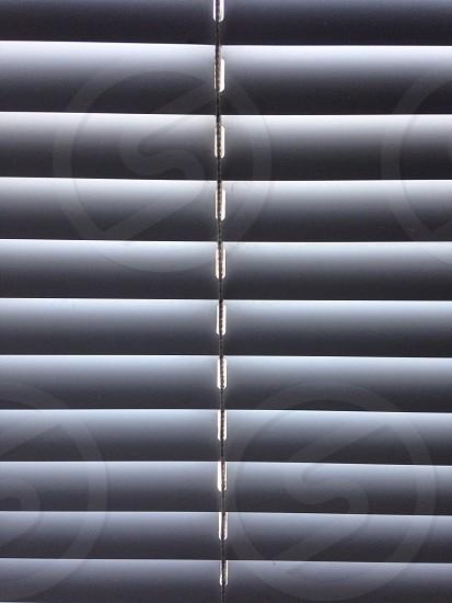 gray window blinds photo