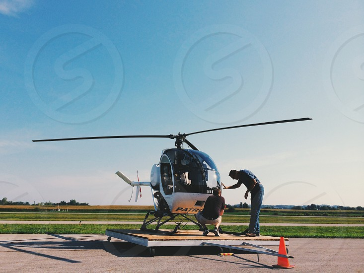 2 man on white 3 blade helicopter photo