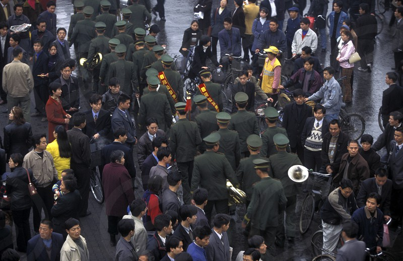 the police or army in the streets in the city of Chengdu in the provinz Sichuan in centrall China. photo