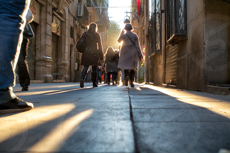 people walking on concrete street photo