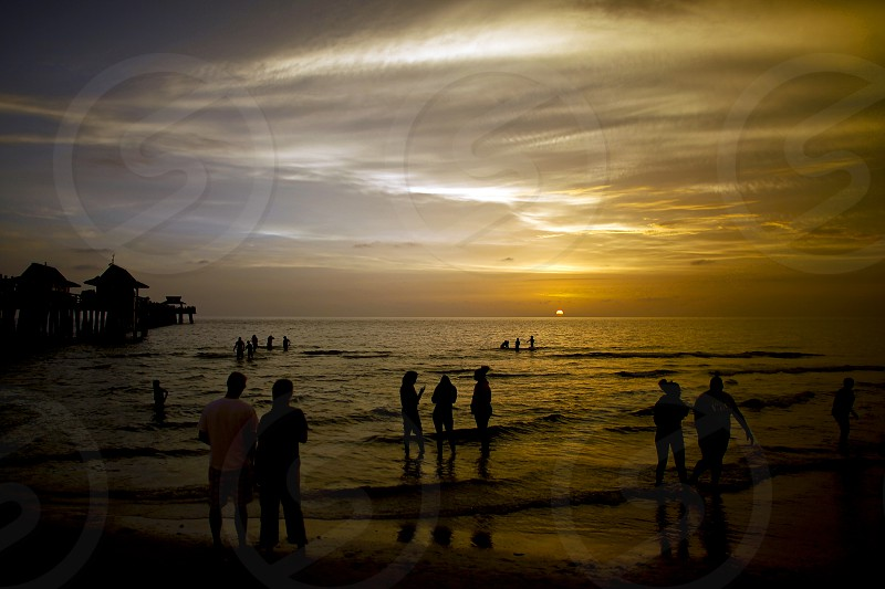 Sunset beach sihlouette silhouette gulf vacation relax unwind Gulf of Mexico travel photo