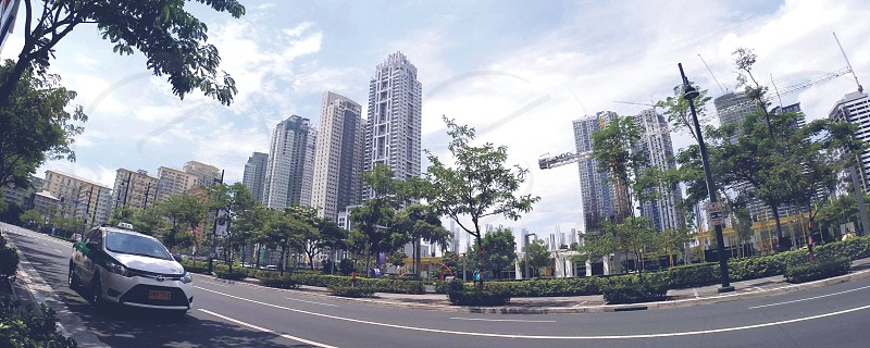 A new city rises next to Makati with big wide avenues and tall buildings and tree-lined sidewalks. photo
